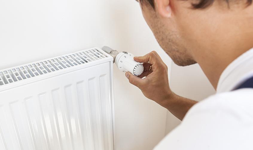 man-increase-temperature-radiator-by-adjusting-thermostat1.jpg